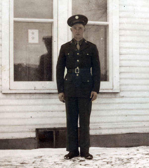 Picture of my grandfather before he left for Europe on January 18, 1945. Notice the flag in the window, each star stood for a soldier in the war. One for him and one for his brother Donald. The flag was known as the