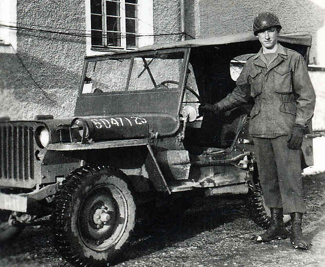 My grandfather next to a jeep in Camp Hallein, Austria.