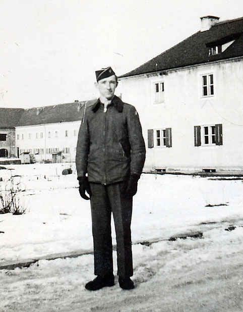 My grandfather in front of the Austrian house he was billeted in.