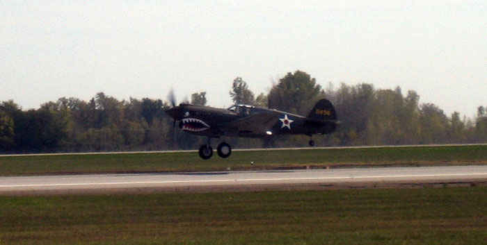 P-40 Warhawk. Made famous by the Flying Tigers, it was a air supremacy fighter, bomber escort and fighter.