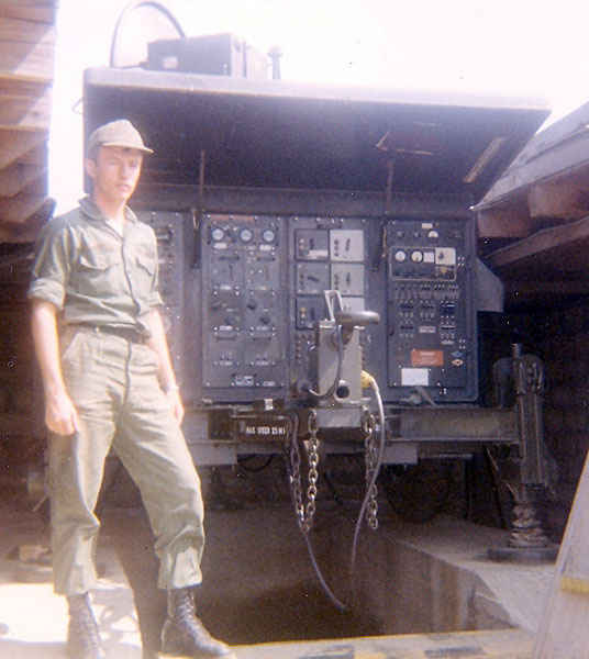 Dennis standing next to a pulse acquisition radar used for tracking incoming enemy aircraftin Korea 1973