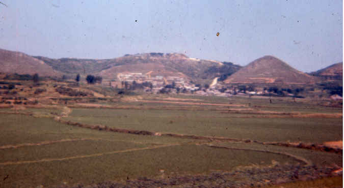 Korea 1973-1974. Rice paddies and thatched roof houses in the farming community near B Battery.