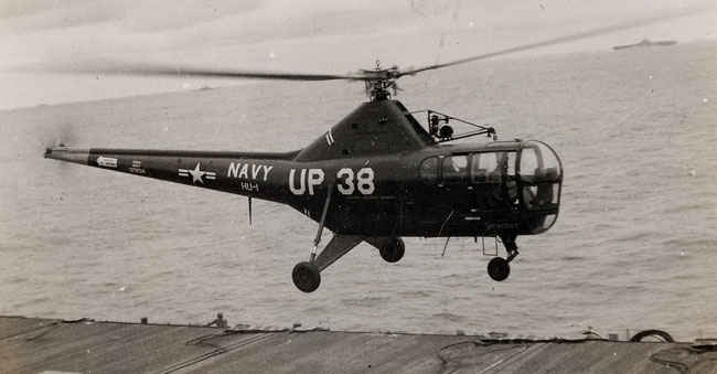 Helicopter flying above USS Boxer Korean War.