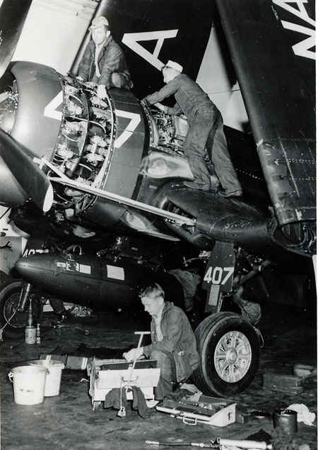 F4U Corsair undergoing maintenance. Each plane would have a plane captain making sure the plan was in flying condition at all times.