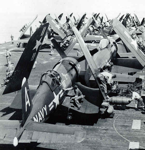 Chance Vought F4U Corsair and - are lined up the deck of the USS Boxer.