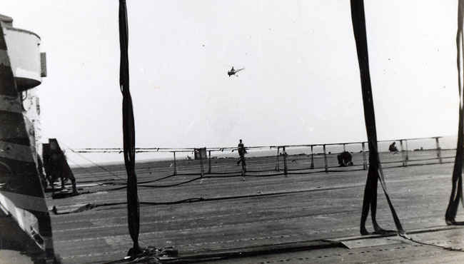 A special cargo net is set for when F9F Panther jets are about to land.