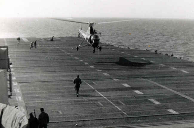 A helicopter would always take off and patrol the water around the USS Boxer during the Korean War when planes were going to land or take off. The reason for this is so that it could pick up any pilots who had to bailout. As you can tell this was a common occurrence during the 1950's.