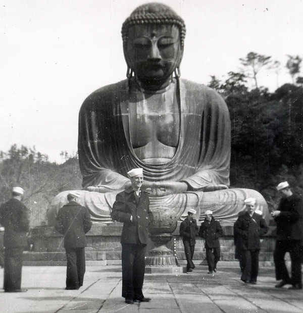 Gene in front of a Buddha during the Korean War in Tokyo.