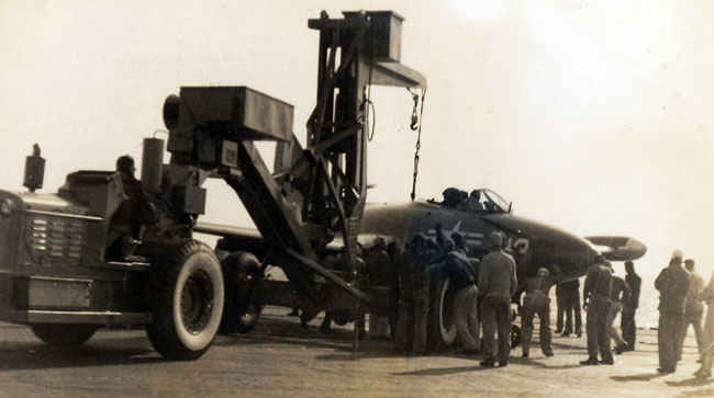 F9F Panther picked up by the tractor loader.