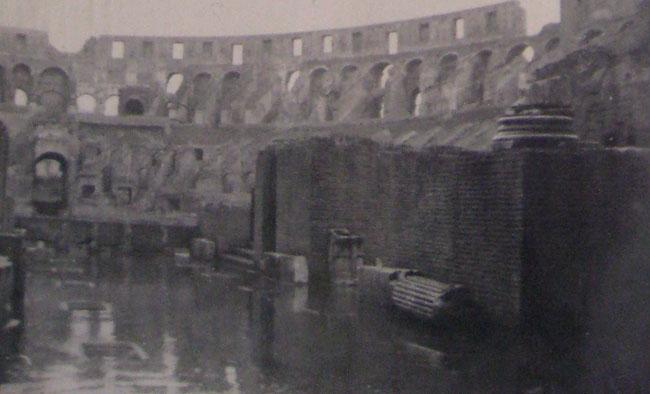 Colosseum in Rome, Italy 1945. Notice the water standing. During historic times the Roman would have Naval battles inside the Colosseum.