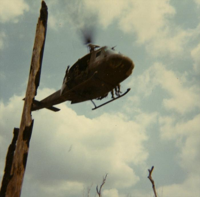 Huey landing in Vietnam to drop off soldiers and supplies.