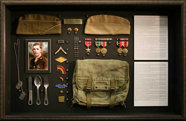 Frame of all Thomas' artifacts from World War II.