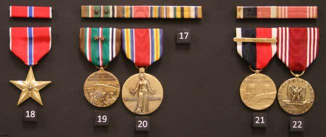 Bronze Star, European-African-Middle Eastern Campaign Medal with Two Battle Stars (Rhineland and Central Europe), World War II Victory Medal  ,Interallied Medal? Not official?,  Army Of Occupation Medal (Germany),  and Good Conduct Medals from World War II.