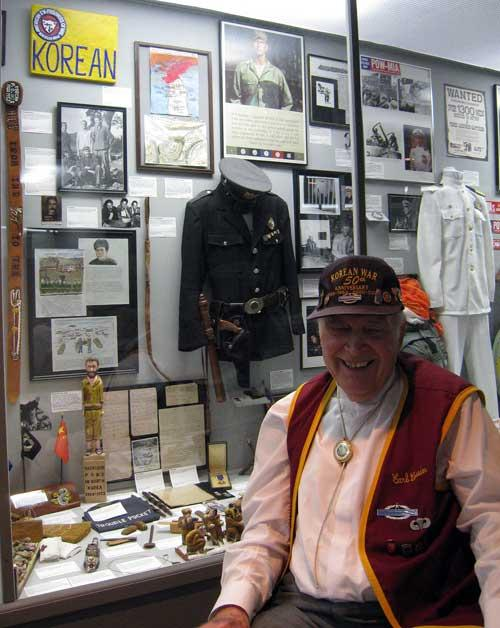 Carl Cossin at the age of 87 sitting in front of his Korean War exhibit at Motts Military Museum, Groveport, Ohio.