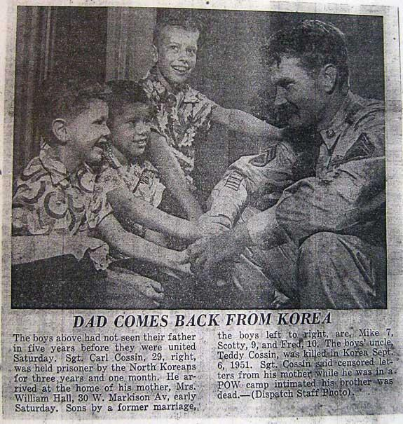 Carl Cossin with this three boys after he was released from North Korea.