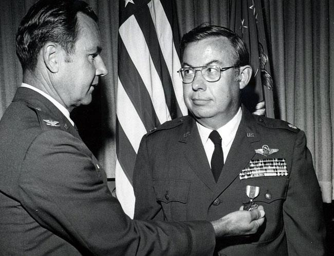 Receiving the Meritorious Service Medal from the Vice Commander of the Air War College, Maxwell AFB, AL in 1973