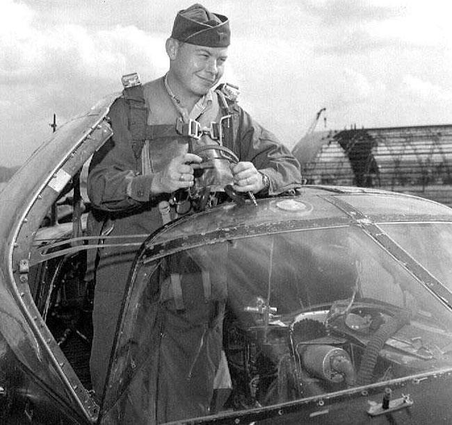 Morris Briggs standing in cockpit of RB-26C at Kimpo Air Base, Korea, 1952.