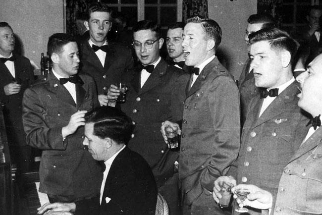 Bringing in the new Year 1957, at Upper Heyford RAF Station, England.  Group singing Auld Lang Syne