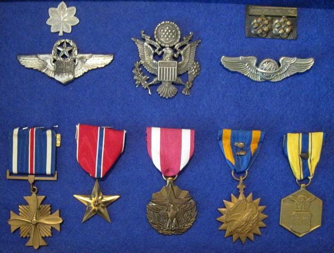 L/R, T/B. Lt Colonel, hat insignia, Lt Colonel Vietnam. Later navigator wings, early navigator wings. Distinguished Flying Cross, Bronze Star, Meritorious Service Medal, Air Medal with two oak leaf clusters, Air Force Accommodation Medal with oak leaf cluster.