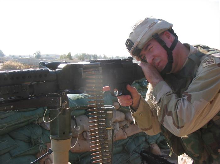 Pic of me manning the 240B Machine Gun providing overwatch, as a military convoy enters the main gate.