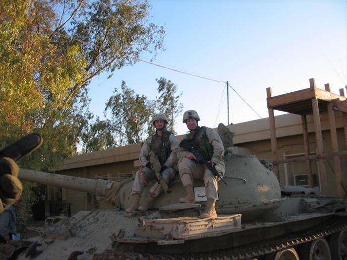 Specialist Dickerson and I posing on a T-55 Russian tank in front of our Battalion HQ.