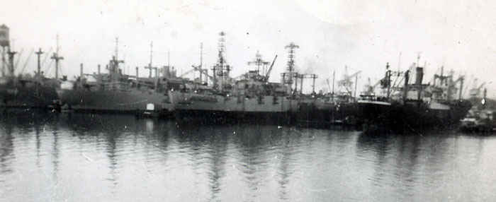 Picture of the Leo in the docks of Sasebo, Japan. The Leo and her sister ships practiced night underway replenishment techniques that helped resolve logistical problems.